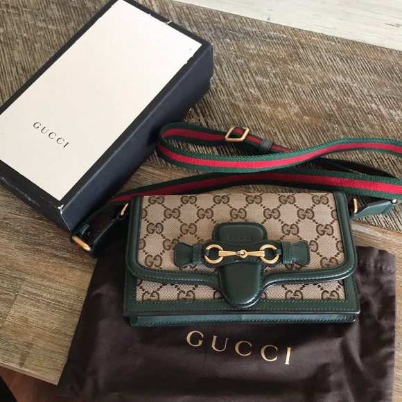 0f131a149779 Gucci Handbags - 100% authentic Gucci lady web convertible wallet